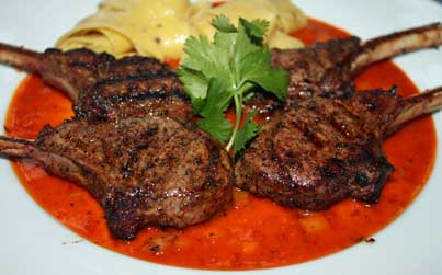 Grilled Chops with New Mexico Red Chile Buerre Blanc Sauce