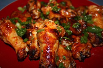 Finger licking Sriracha spicy chicken wings